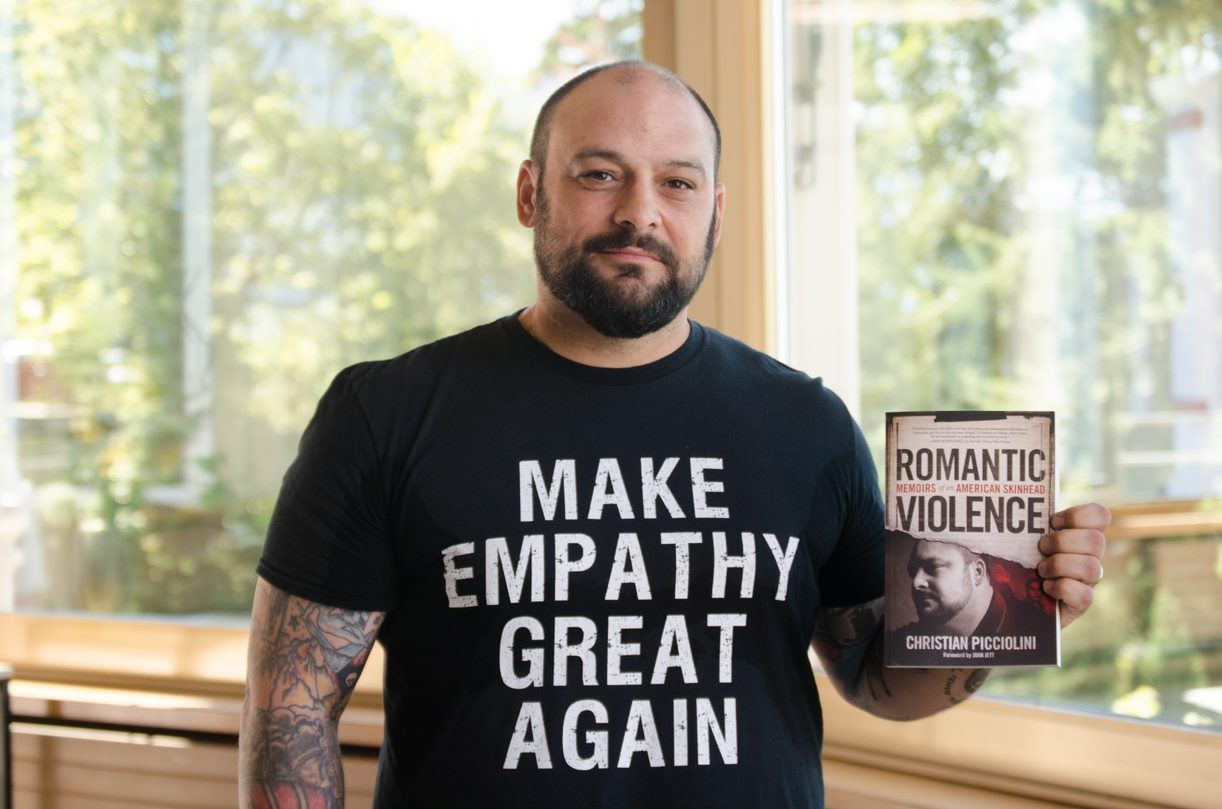 Christian with his book Romantic Violence: Memoirs of an American Skinhead