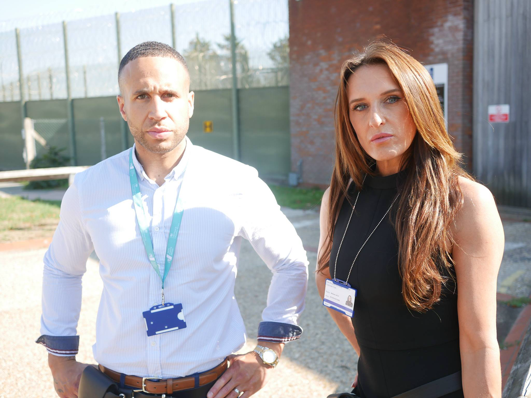 Dwayne and Mel outside Feltham Young Offenders Institution,, where they work to help young prisoners move beyond a life of crime.